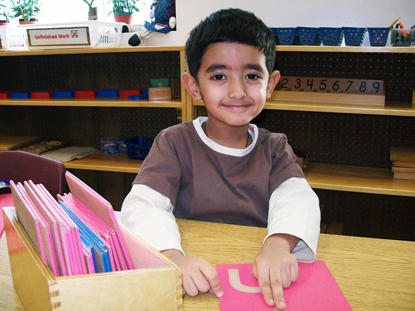 Student using the Sandpaper letters