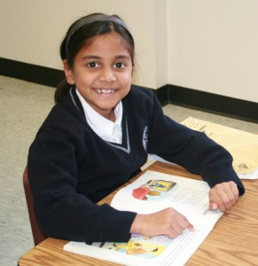 Photo of TCMPS Private Elementary School student reading a book