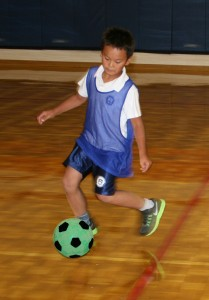 Photo of TCMPS Elementary School student playing Soccer