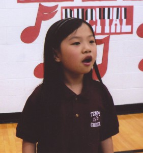 Photo of TCMPS after school choir program teacher with 2 students dancing