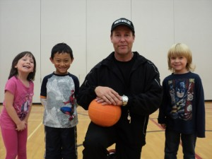 Photo of TCMPS after school sports program teacher with students in the Gym