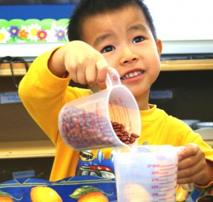 Photo of TCMPS student participating in Practical Life studies