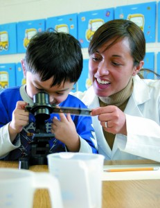 Photo of TCMPS after school science teacher with student