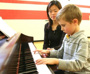 Photo of TCMPS after school Piano & Music program teacher with student