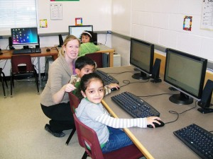 Photo of TCMPS Computer Club program students in the lab
