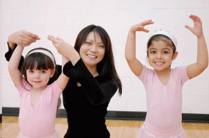 Photo of TCMPS after school ballet program teacher with 2 students dancing