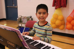 Pre-School student in After School Course piano lessons.
