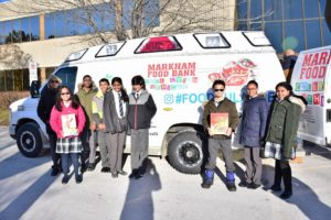 Elementary Student Activity Council student help the Markham Food Ambulance with donations