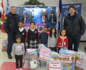 TCPS Pre-School students and York Region Fire Department with toy donation.