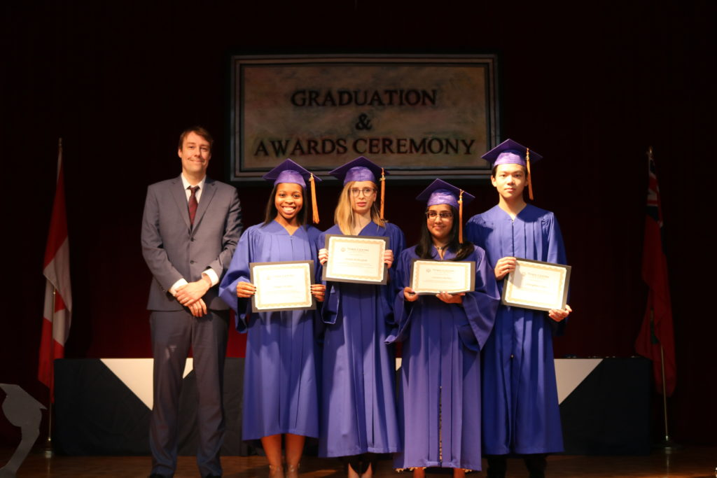 Award presentation during grade 12 graduation ceremony