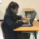 High School student working at her laptop